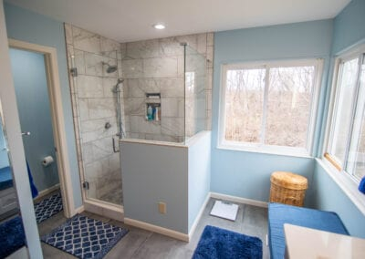 Aqua colored and Marble Tiles in Standing Bathroom